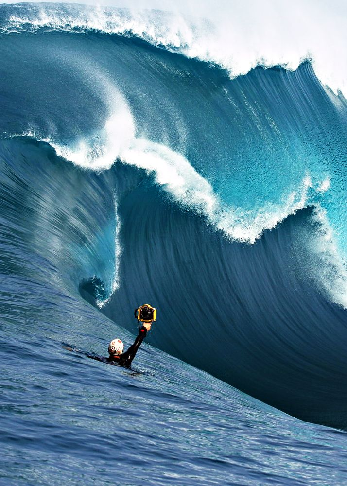 Cameraman in the waves taking his shot while another is taking this one...amazing.  Photo by Trent Slatter
