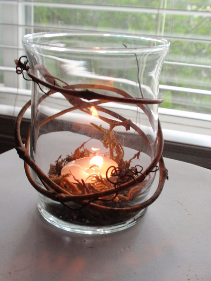 Rustic Wedding Decor Winding Grapevine Candle Holder with Spagnum Moss. $10.00, via Etsy.