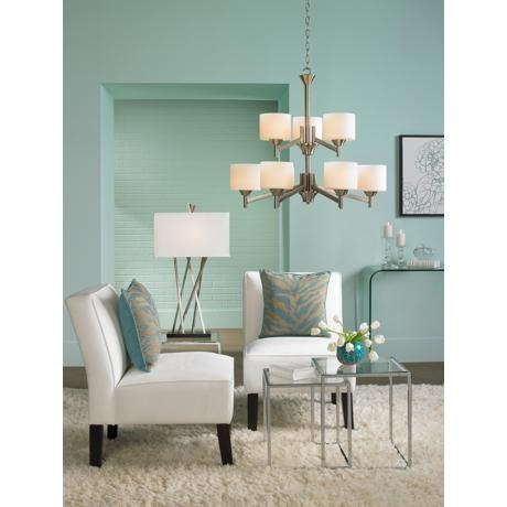 A bold and modern table lamp accents a contemporary living room brushed steel and white