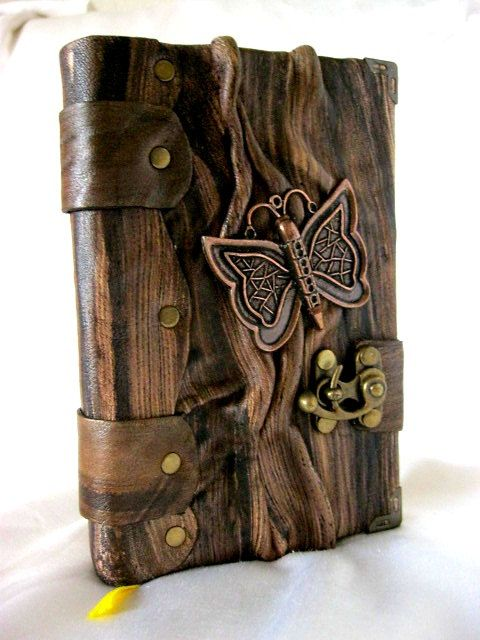 Handmade blank leather journal notebook with steampunk Butterfly emblem in Brown. via Etsy. (V)