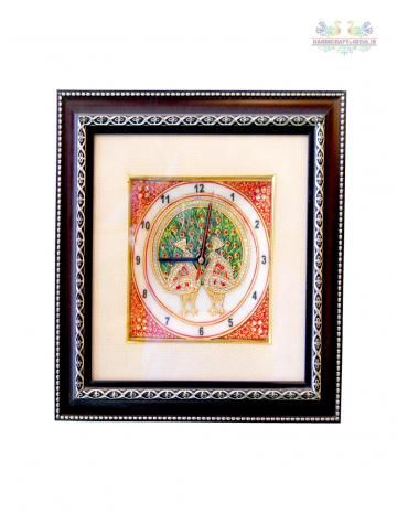 Wall clocks have evolved from a mere utility to stylish, home decor items! Exemplifying the same, this appealing wall clock will not only keep you informed about the time, but will spruce up the look of your living room as well. Made up of wood and marble, the decoration on the wall clock is golden work with different colors and artificial stones