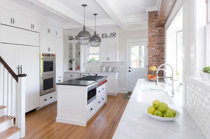 New York Modern Kitchen Design Ideas with white cupboard and white wall