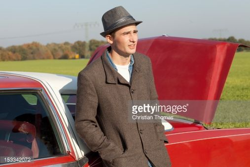 A Young Rockabilly Man Leaning Against A Vintage Car In The Country Stock Photo | Getty Images