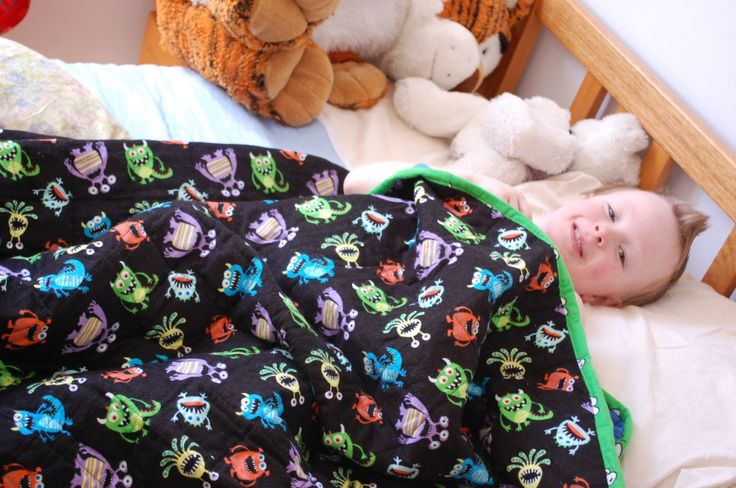 Isaac snuggled up under his new Hippo Hug weighted blanket. Weighted blanket use with young children with sleep issues