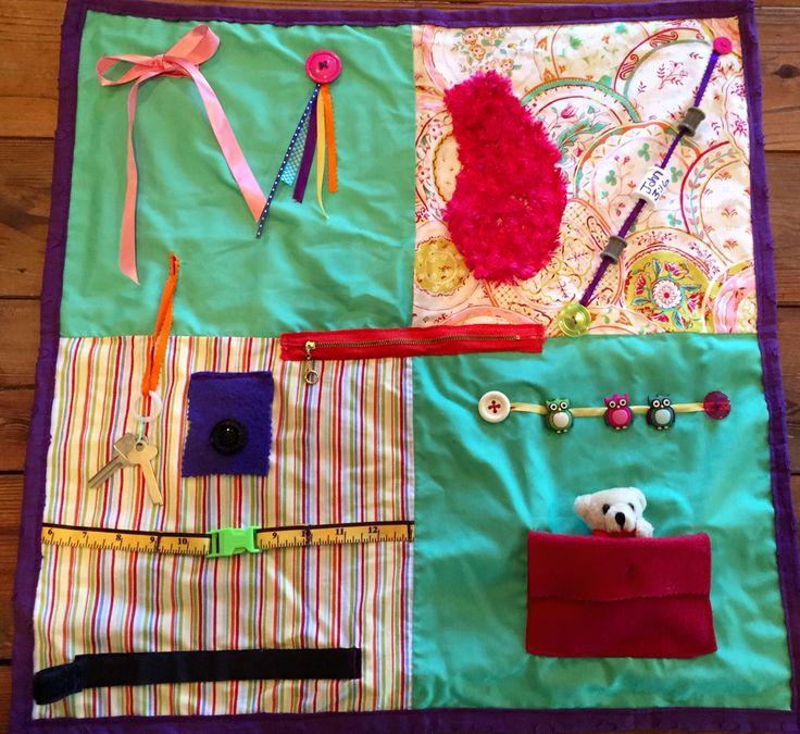 Fidget quilt for Alzheimer's & Dementia. Keeps hands and mind busy . Buttons, zippers, jets, buckles, Velcro , pocket & teddy bear.