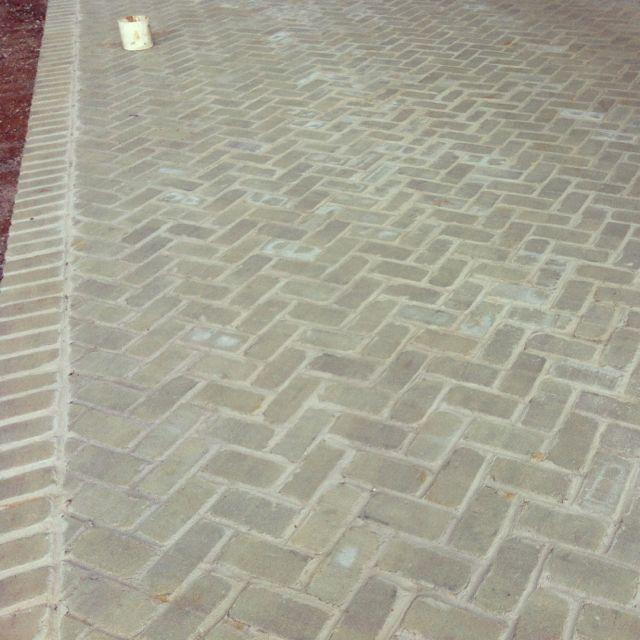 Herringbone patio at one of my current jobs. Love the gray brick