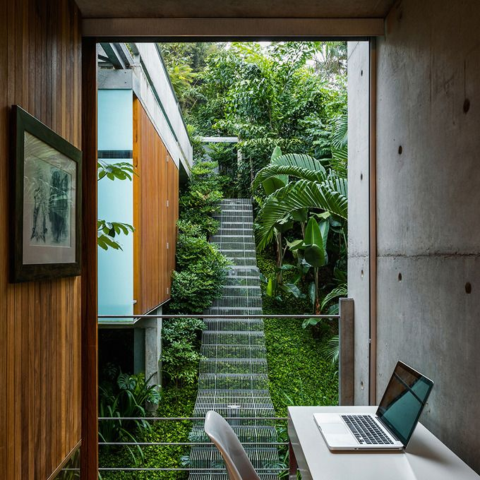With the aim of having as little impact on the environment and ecosystems of the area as possible, SPBR Arquitetos set out to create this home in Ubatuba, Brazil. While the entirety of the house features unique details that help make it environmentally friendly, one of the most interesting design elements is the outdoor staircase. Rather than excavating the land and creating steps using solid c..