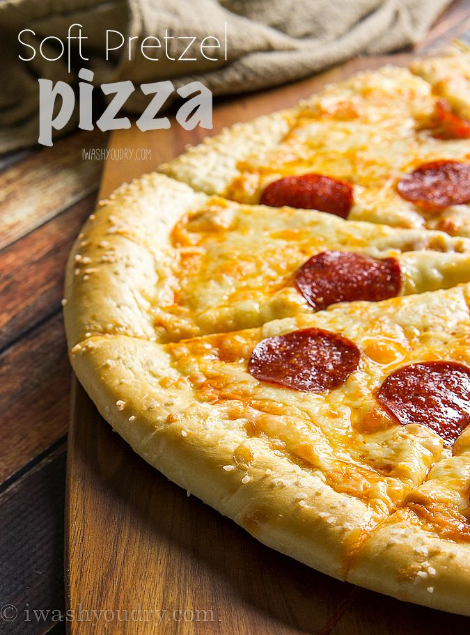 Pretzel Pizza!! The crust is made of soft pretzel dough, and then it's topped with nacho cheese sauce and the classic pepperoni and cheese toppings. It's out of this world!