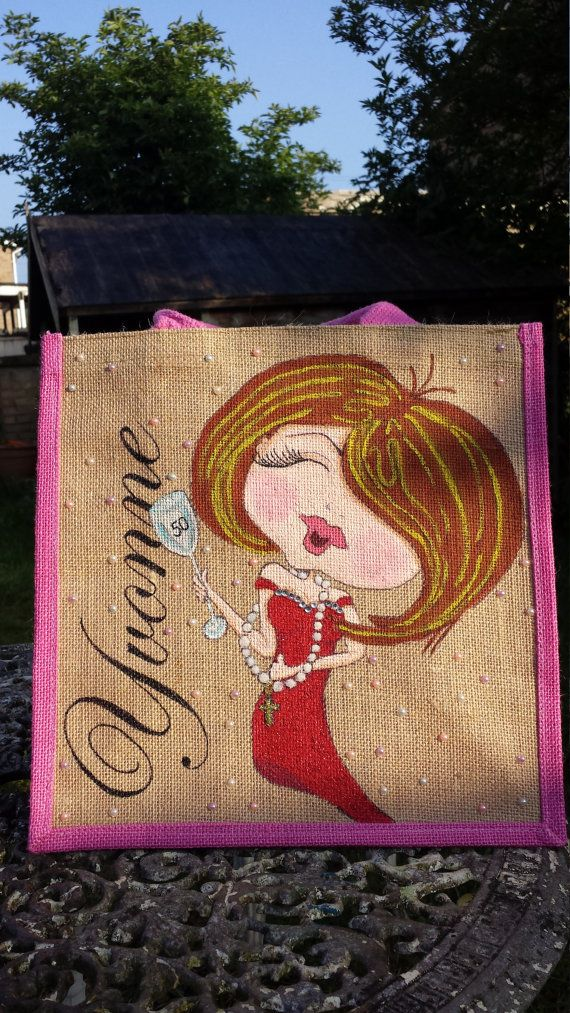 Hand painted to order is this fabulous new charicature bag. Originally designed by one of my favourite artists - Sherri Baldy from her Bestie range. Because it is hand painted to order, you can change the hair and dress colour. The number 50 in the glass has been added to suit customer but this will be omitted on the bag you receive.  I always finish off the bags with glitter, crystals and faux pearl cabochons as standard. If you would prefer not to have these added to your bag, please just…