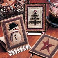 """Holiday Greetings - Linda Davis combined quilting and card making to create these delightful easel cards. Use her ideas to design your own holiday greeting cards.    Size: 4¼"""" × 5½"""": Quilts Patterns, Homemade Christmas Cards, Quilts Christmas, Christmas Holidays, Quilts Cards, Greeting Cards, Holidays Greeting, Holidays Cards, Combinations Quilts"""