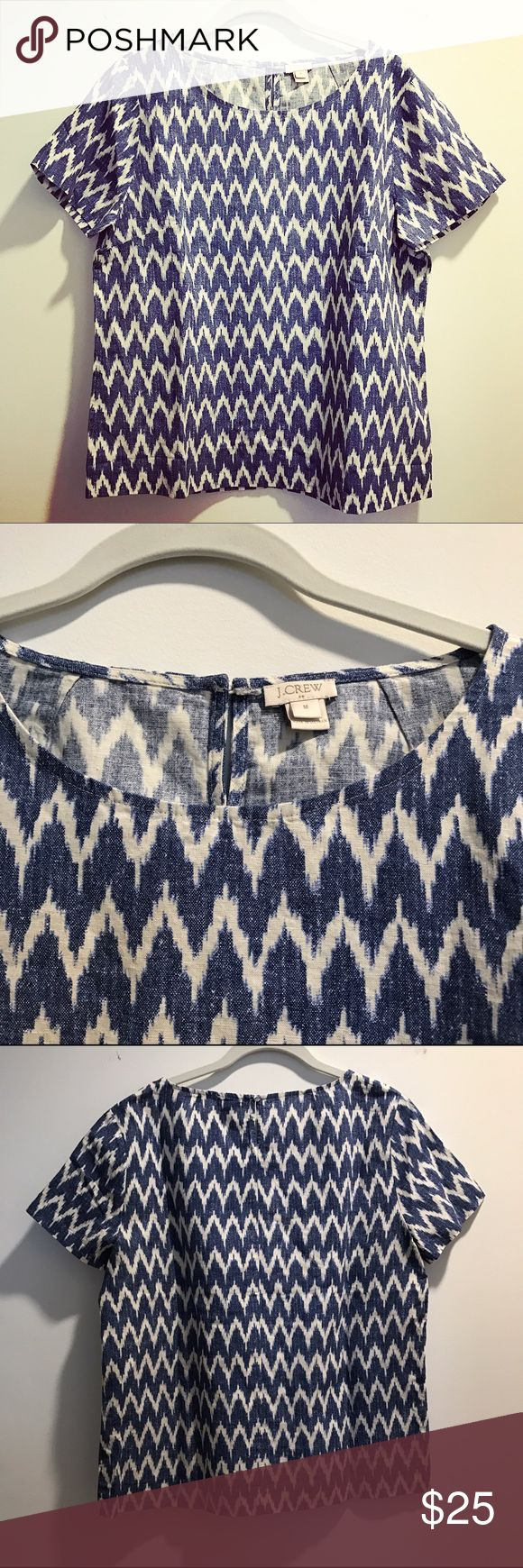 J. Crew short-sleeved top in zigzag ikat Short-sleeved top in zigzag ikat from J. Crew. Blue and white, with a buttoned back. The shirt is 55% lin and 45% cotton. The top is meant to be a bit oversized. J. Crew Tops Tees - Short Sleeve