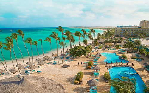 NOW ON SALE AT WESTJET.COM Save $600 instantly at Holiday Inn Resort Aruba - Beach Resort & Casino. Book a minimum 7-night vacation package to the Holiday Inn Resort Aruba - Beach Resort & Casino and receive up to $600 of instant savings.