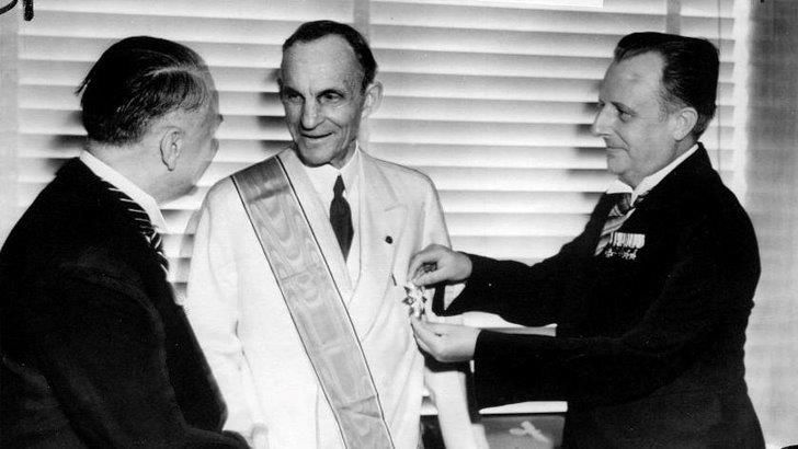 1938 Henry Ford accepts the Grand Cross of the German Eagle from German Government Officials