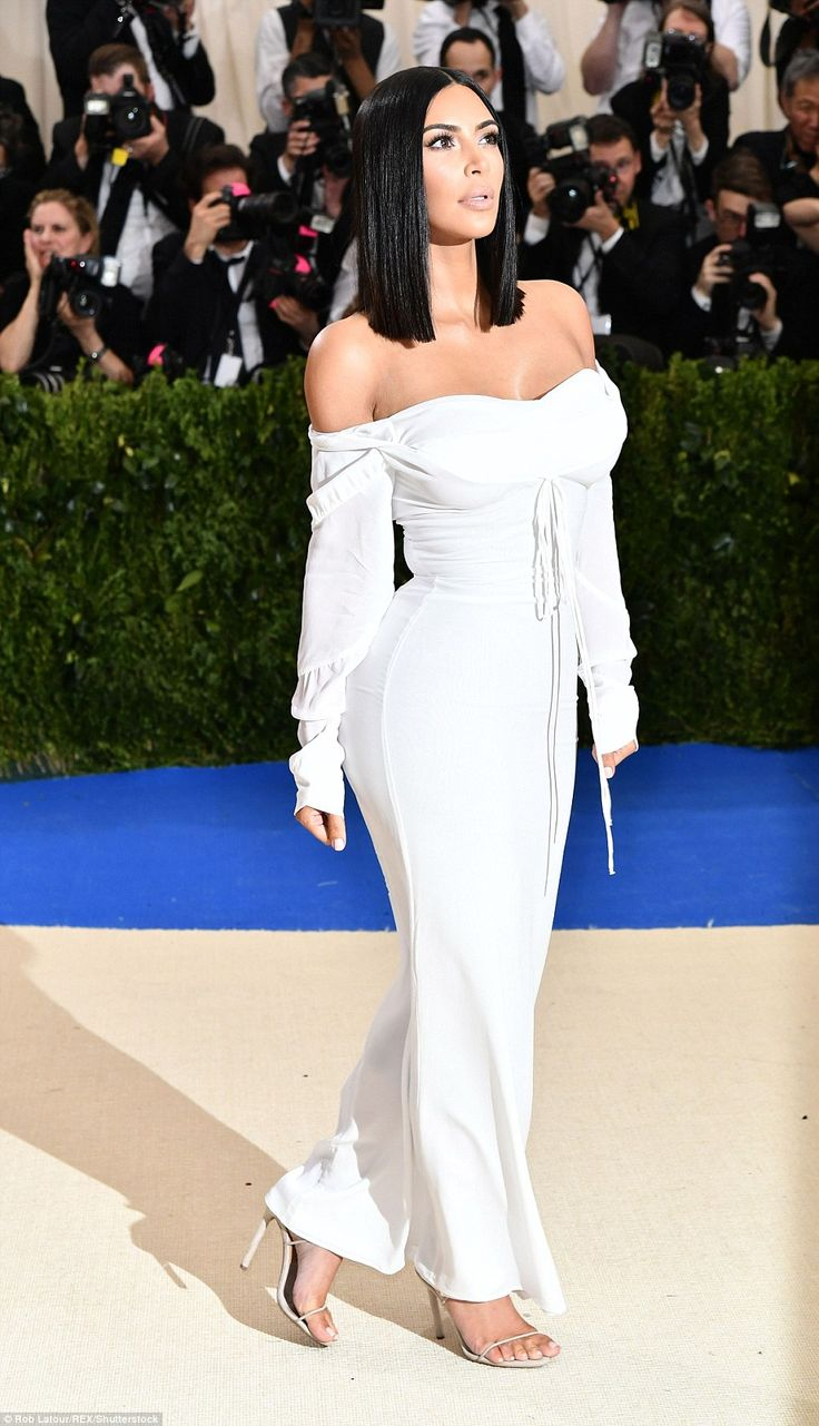 Understated: Kim, 36, who is famous for baring her skin, stunned in the very simple dress...