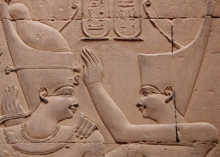 the Goddess Outo/'Uadjet' (wearing the Red Crown) crowning King Ptolemy VIII Euergetes II. Detail from the Double Temple of Haroeris (Horus the Ancient) and Sobek at Ombos, Inner Hypostyle Hall, west...