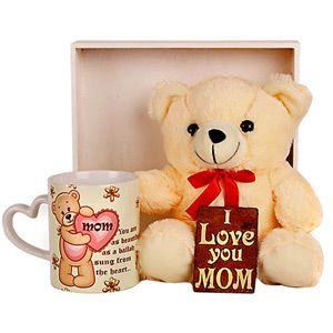 Hamper includes: Teddy bear. Size: 10 inches. Mother special table top memento. Size: 65 x 65 mm. Mother special white ceramic coffee mug. Placed on a wooden tray. Rs 1049/- http://www.tajonline.com/mothers-day-gifts/product/md1928/tender-mother/?aff=pint2014/