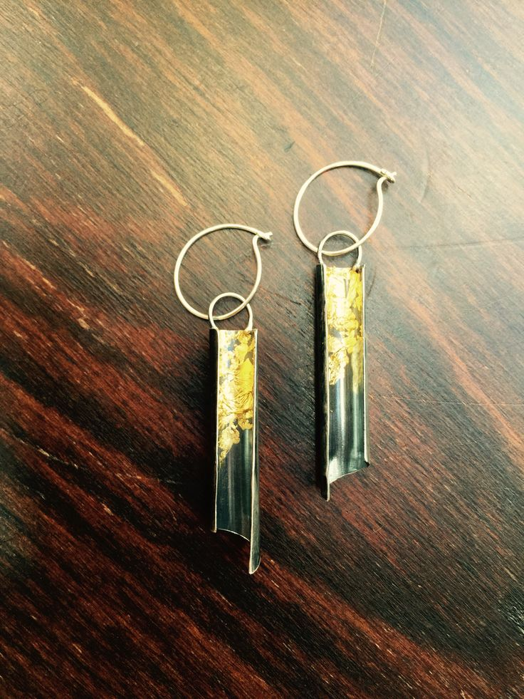 Silver and 24k gold earrings by Buster Collins