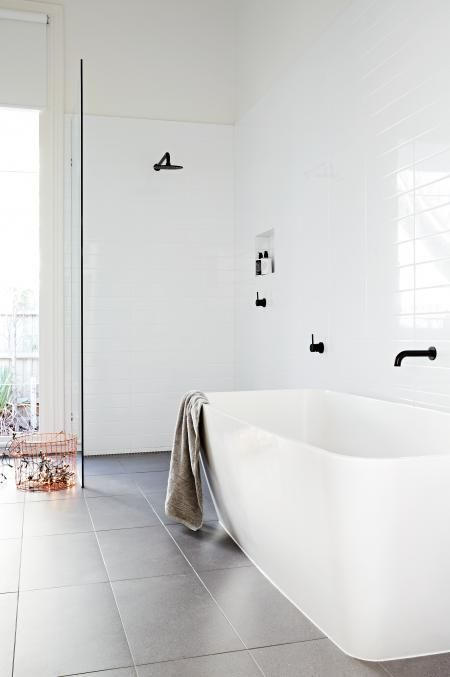 shower wall this way! Solves all the problems! simple design white bathroom black tapware