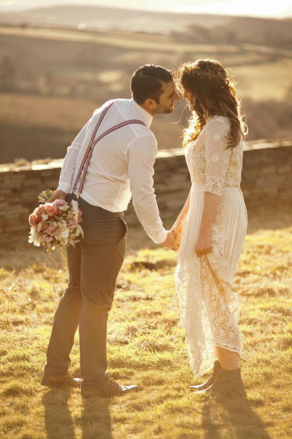 lace dress, 3/4 length sleeves, floral wreath in hair, groom's suspenders.