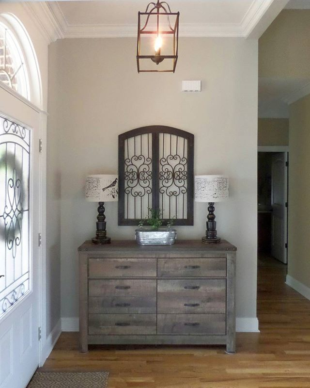 Rustic Entryway Decor With Dresser And Metal Wall Decor