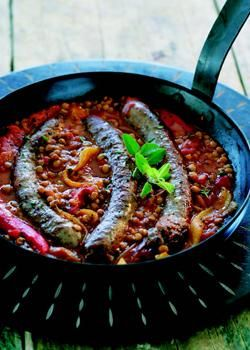Ostrich sausages with tomato and lentils