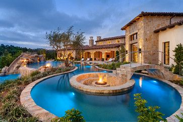 Fire Pit inside of Pool.  Love the way the pool extends the length of the house...