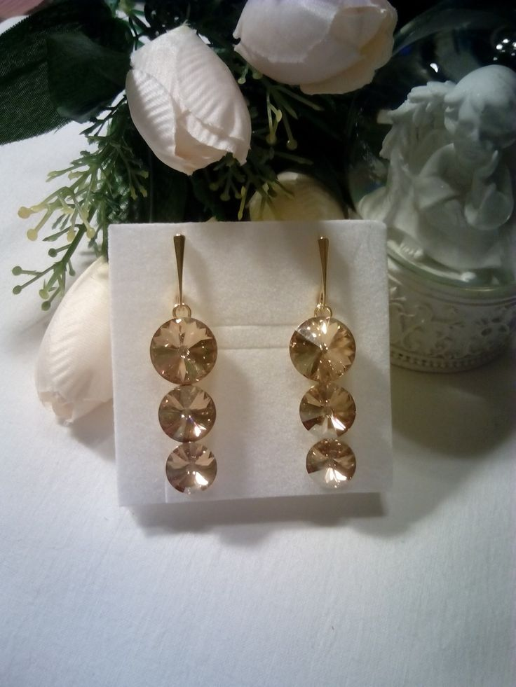 Gold plated silver earrings with golden shadow Swarovski crystals.