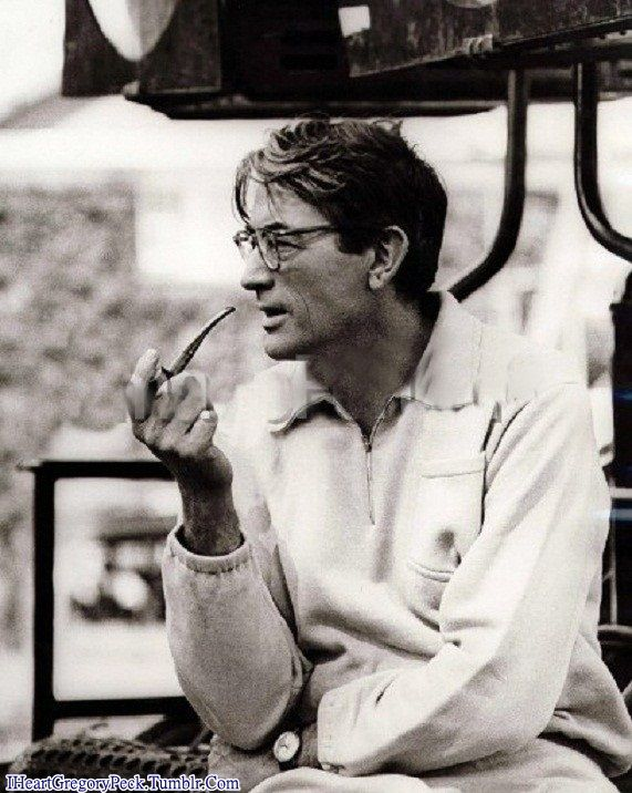 Gregory Peck is smoking a pipe.