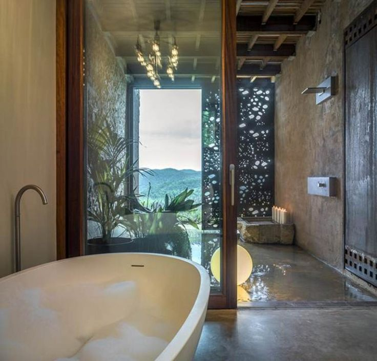 Bathroomopening sculptural steel door with exterior entrance to natural bathtubs with nature view most