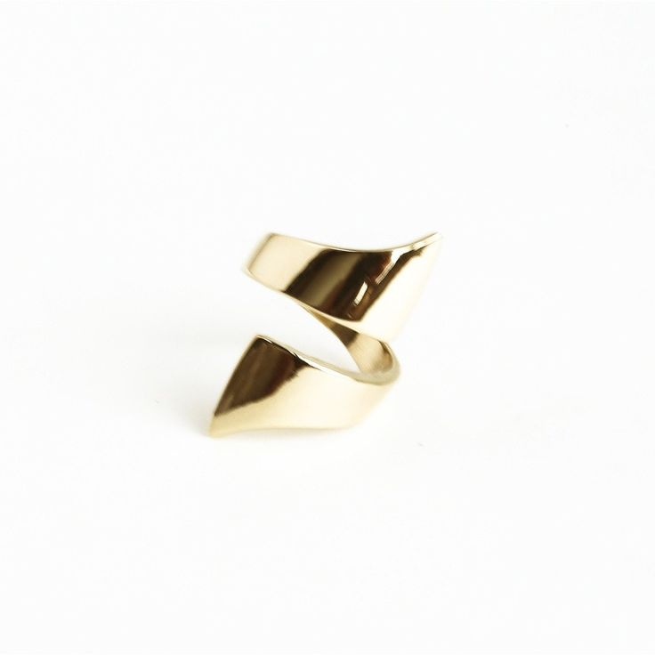 Part statement, part modern artwork, this gorgeous minimalist ring adds a subtle touch of class to any outfit. Material: Brass. Item fit/Dimensions: Adjustable. Lead Time: 5 - 7 days.