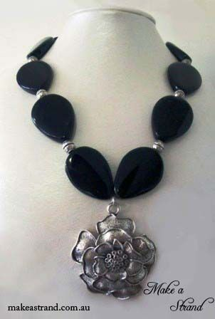 Large black agate teardrops and silver metal beads showcase this beautiful silver metal flower pendant In stock: AU$150 + postage Click image to buy.