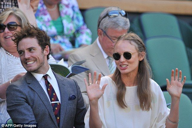 Sam Claflin gives wife Laura Haddock a playful pat on the bum #dailymail
