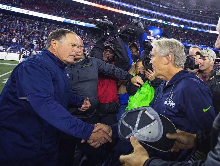 Seahawks vs. Patriots:  31-24, Seahawks  -  November 10, 2016  -   New England Patriots head coach Bill Belichick and Seattle Seahawks head coach Pete Carroll shake hands after the game. (Mike Siegel / The Seattle Times)
