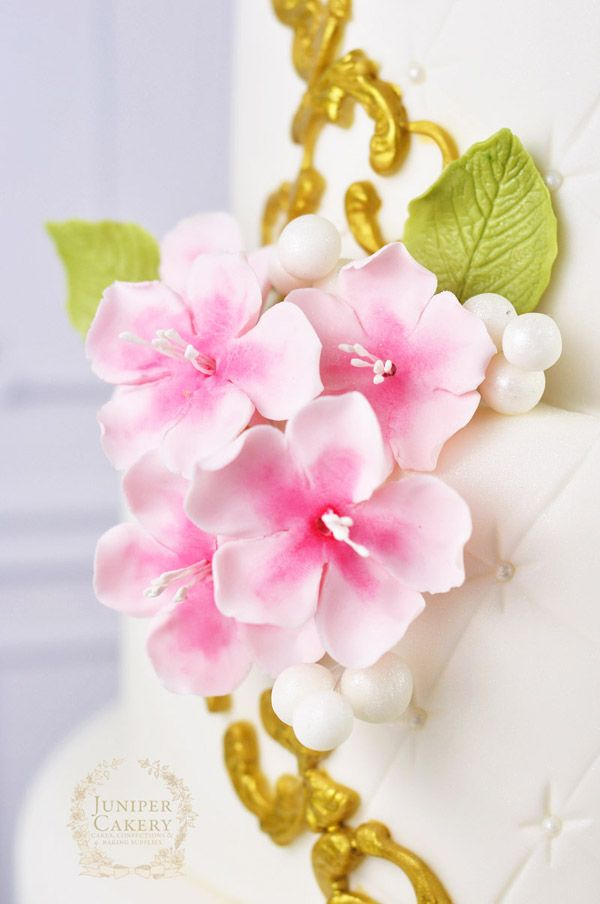 Delicate yet intricate, cherry blossoms are a cake decorating classic. Learn how to create realistically beautiful edible cherry blossoms using gum paste!