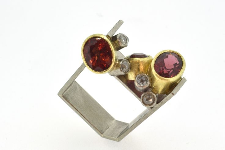 Chris Boland : constructed jewellery, handmade to emphasise the qualities of the gemstones inclusions. All work made from natural stones and precious metals