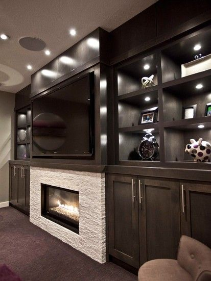Dark Custom Stain For The Built In Maple Media Cabinets Camouflage The TV.  Stand Out Was The Fireplace, Which Is Surrounded With A White Ledgestone ...
