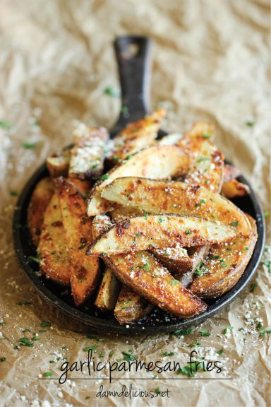Garlic Parmesan Fries - Amazingly crisp, oven-baked fries coated with freshly grated Parmesan and a generous dose of garlic goodness! Fabulous dinner side.