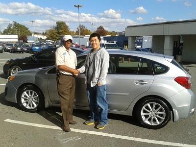 Folger Subaru Sales Consultant Bill Barber with Mr. Herr and his 2012 Subaru Impreza 5-Door hatchback!