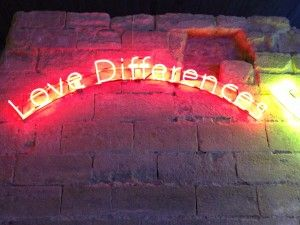'Love Differences' Neon by Michelangelo Pistoletto at a 2010 exhibition in the Louvre, Paris