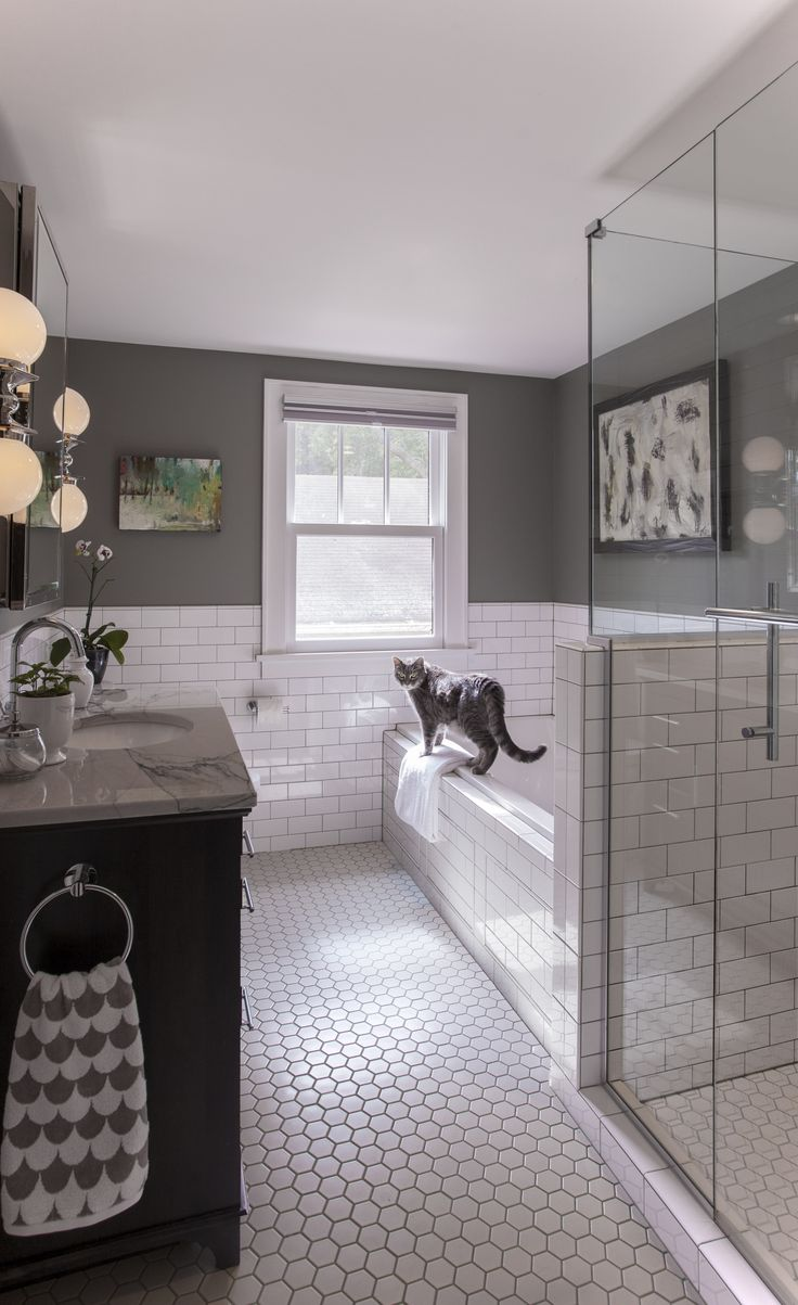 The Art Gallery This look white hex floor tile with white subway tile in the bathroom