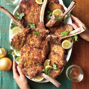 "Veal Chops Milanese with Lemon and Herbs | MyRecipes.com Ask your butcher to ""french"" the chops for you so you take home clean meat that's ready to prep."