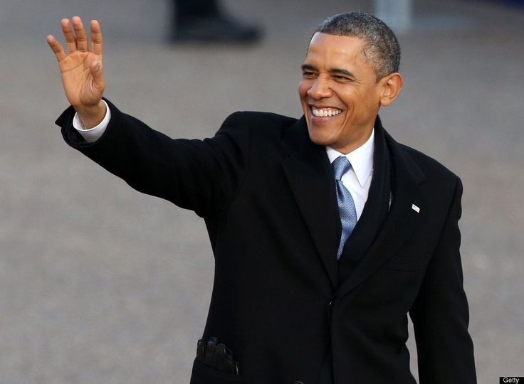 U.S. President Barack Obama waves as the presidential inaugural parade winds through the nation's capital January 21, 2013 in Washington, D.C.