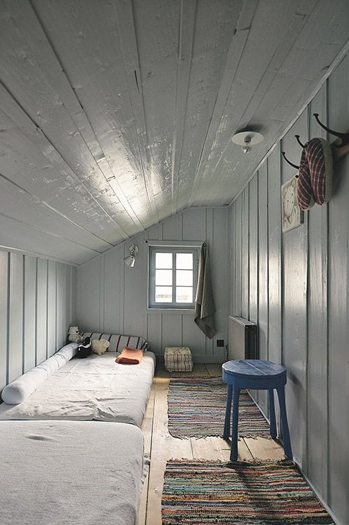 Sleeping alcove harmony: High gloss paint magnifies natural light; cool gray and blue SOOTHE; natural fiber bed linens and wood WARM; linear beds use space well.
