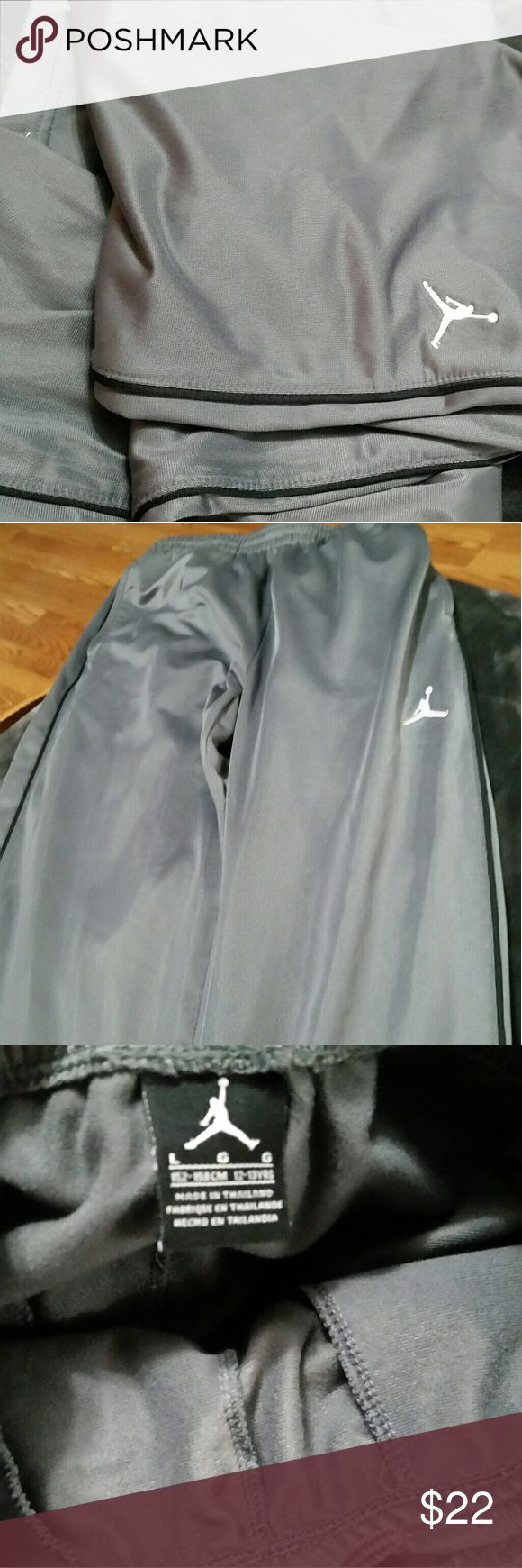 Size L boys Nike Air Jordan warm up pants Grey with a black stripe down the sides Air Jordan warm up pants for boys. Size large.  Excellent condition with no stains or snags. Even smooth clean edges at the ankles. Drawstrings are perfect too! Your son can't lose with these trainers!!! Nike Bottoms Sweatpants & Joggers
