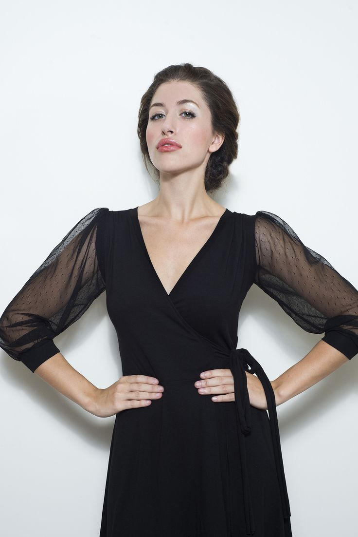Black soft jersey dress wraps around the body and ties around the waist.  Puffy sheer sleeves, ¾ length