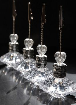 """14.00 SALE PRICE! Crystal Place Card & Table Number Holders.. weighted acrylic. 1.25"""" alligator clip on the top. each is 5"""" tall x 2"""" wide. re..."""