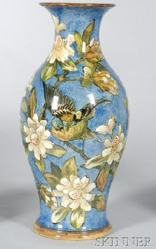 A Doulton Lambeth Faience Vase, polychrome enamel decorated with birds among magnolias to a blue ground, England, circa 1870-1880