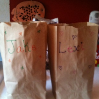 Goodie bags for busy days in the car or running errands.. Just a brown paper bag, snacks, drink, crayons/toys and something to color in.. I put my kids names on the front.. They love these