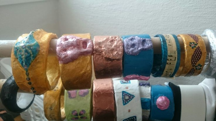 A whole bunch of my first bracelets from cartoonrolls and papermache