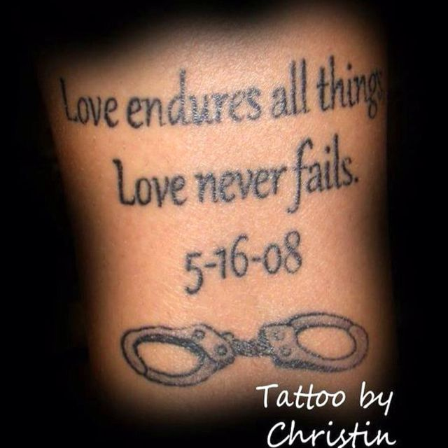 Tattoo Of Our Wedding Anniversary Date And Handcuffs Are